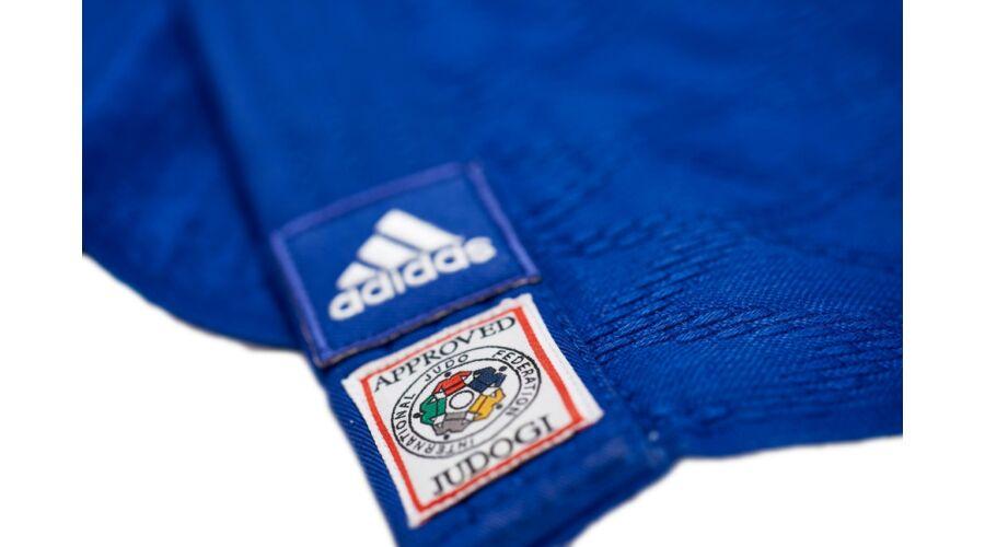 9e0cd4cf2 Adidas Champion II IJF Judo gi kék, fehér vállszövéssel.